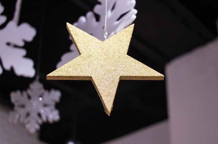 close up photography of star covered with glitters